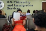 A Colombian immigrant studies ahead of her citizenship exam at the U.S. Citizenship and Immigration Services (USCIS) Queens office on May 30, 2013 in the Long Island City neighborhood of the Queens borough of New York City