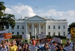 Immigration reform protesters gather in front of the White House on July 17, 2014 in Washington, DC. The protest was organized by Amnesty International to push the message 'Don't Send Unaccompanied Migrant Children Back.' Amnesty International and the pro